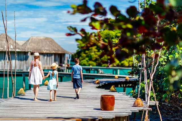guests-family-mother-daughter-son-walking-overwater-villas-song-saa-private-island-2017